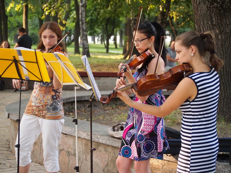 A violin trio performing for tips in the Val park in Chernihiv, Ukraine